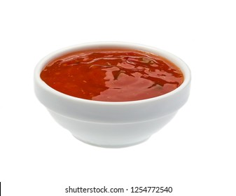 Sweet chili sauce in bowl isolated on white background. Portion of red hot chilli pepper sauce