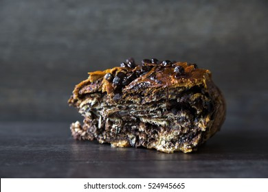 Sweet Chocolate Babka Swirl Dessert Bread Pastry on a Dark Background