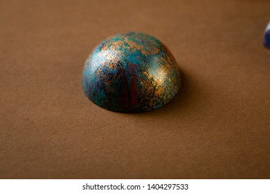Sweet chocolate bonbons on brown background