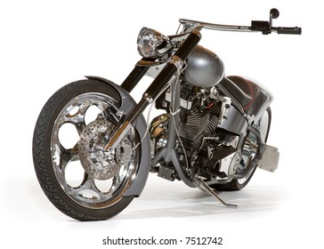 Sweet chopper motorcycle with lots of chrome. Low angle front view. Isolated on white with minor shadow left to avoid the floating in space look, easily removed with a 20% highlight dodge if desired.
