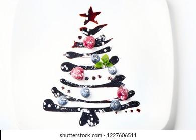 Sweet  christmas tree on white plate