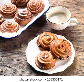 Sweet Cinnamon, Raisin and Poppy seeds Buns on Rustic Table.