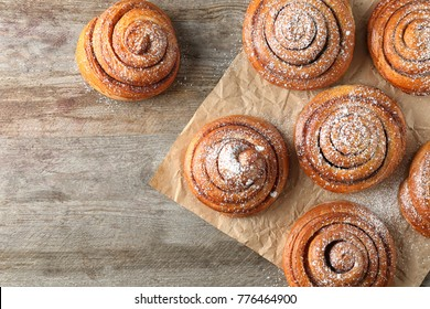 Sweet cinnamon rolls on table