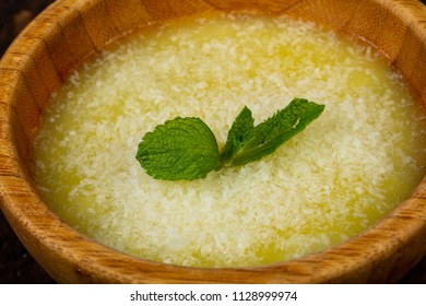 Sweet coconut puding with mint