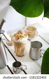 Sweet coffee dessert. Coffee with salty caramel and nuts.