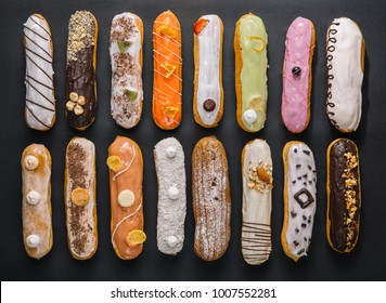 sweet and colorful eclair on black background. french eclair. top view