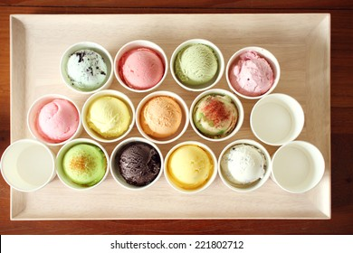 sweet and colorful ice cream scoops on wooden plate