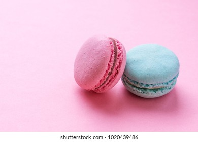 Sweet colorful macarons, on pink background