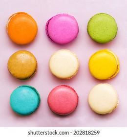 Sweet colorful macaroons on pink background