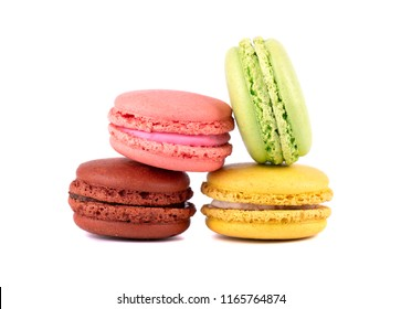 Sweet and colourful french macaroons or macaron on white background. Dessert