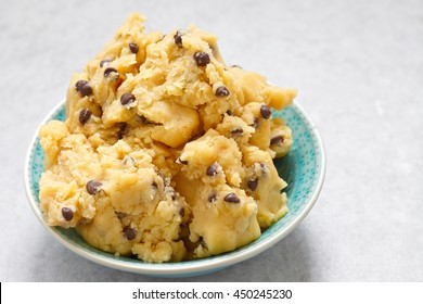 Sweet cookie dough with chocolate chips on a table