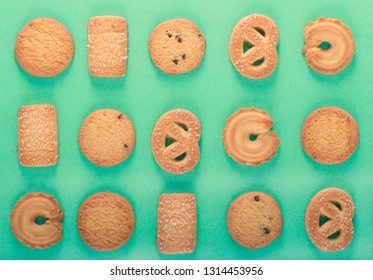 Sweet cookies different shape over green background