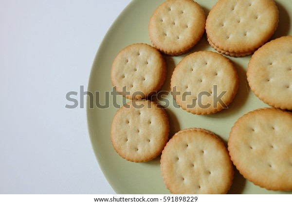 sweet cookies in green dish