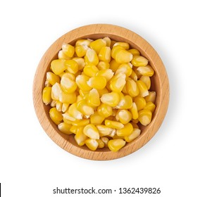 Sweet corn kernels in wooden bowl in white background. Top view