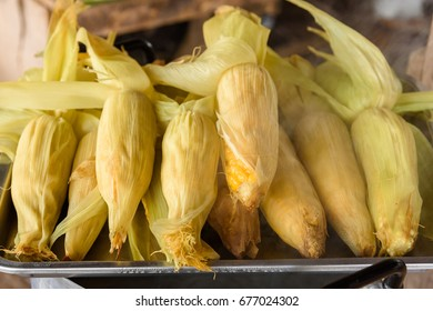 Sweet corns boiled on stainless steel pot in the market,Thailand