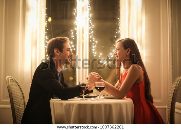 Sweet couple celebrate their anniversary in a romantic restaurant