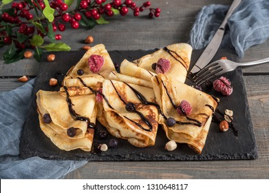 Sweet crepes wrapped with fresh berries and chocolate