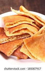 Sweet crispy pancake filled with peanuts, sugar and sweet corn.