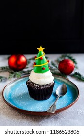 Sweet cup cake with Christmas tree,selective focus