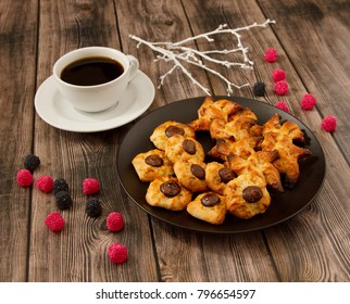Sweet curd biscuits on wooden background