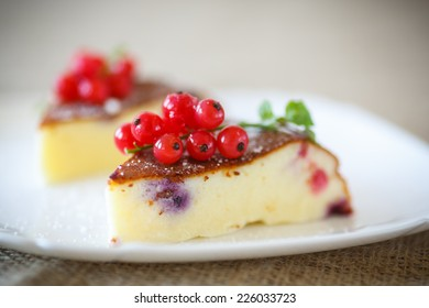 sweet curd pudding with berries on a plate