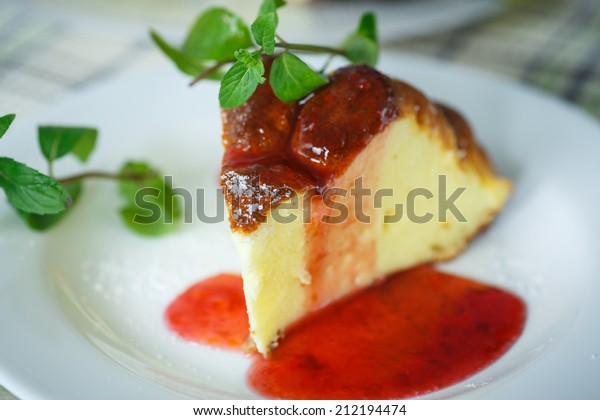 sweet curd pudding with fruit jam on a plate