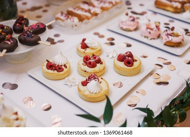 Sweet decorative wedding cakes on a plate with bright, clean, white background