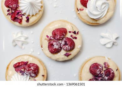 Sweet decorative wedding cakes on a plate with bright, clean, white background. Flat lay, top view