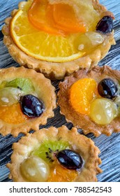 Sweet delicious meal. Muffins with colorful and fresh fruits.