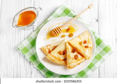 Sweet delicious pancakes with honey and raisins. Breakfast. The concept of food, breakfast,  pancake week.