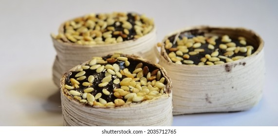 Sweet delicious traditional snacks from Gresik Indonesia named Jubung, made from sticky rice and sesame seed on top of them in white background