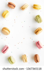 sweet dessert frame with macarons on white background flat lay mockup