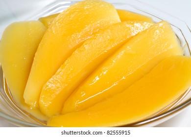 Sweet dessert: Mango slice in syrup