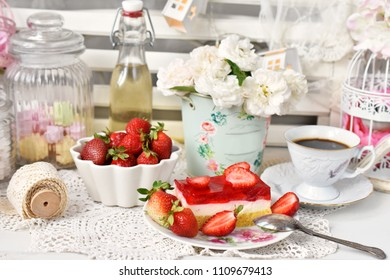sweet dessert with strawberry jelly cake ,coffee and fresh fruits in shabby chic style interior