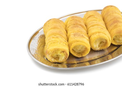 Sweet Dish Puff Roll with Cream Also Know As Homemade Cream Roll, Bakery Food  Isolated on White Background