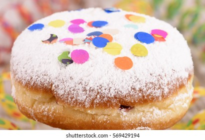 sweet donut with confetti at carnival
