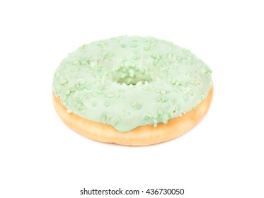Sweet donut with green glaze isolated on white background