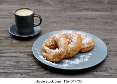 sweet donuts in sugar and coffee
