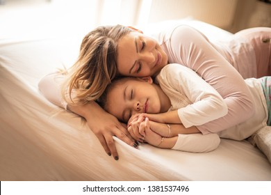 Sweet dreams. Mother and daughter in bed.