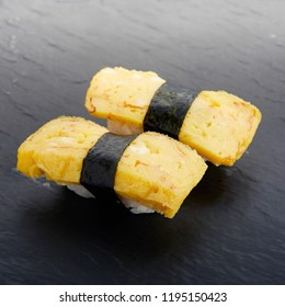sweet egg sushi japanese food traditional with rice vinegar seaweed nori