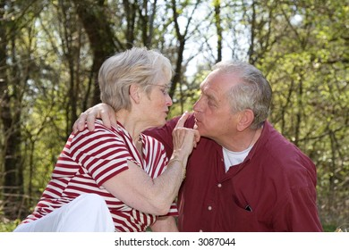 Sweet elderly couple outdoors on a hot summerday