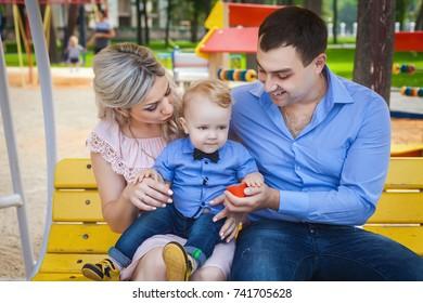 sweet family walking in park