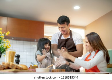 sweet family weekend activities cooking together with dad mom and daughter happiness moment and joyful hobby home kitchen background