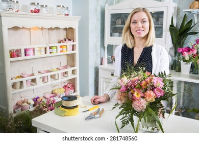 Sweet female florist welcomes her new customer