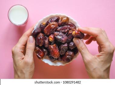 Sweet food for Ramadan. Milk and dates fruit.