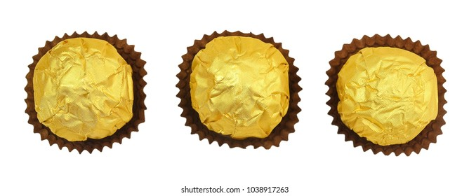 Sweet Food, Top View of Three Round Chocolate Candy Balls or Chocolate Bonbons in Golden Wrapper Isolated on White Background.
