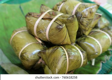 sweet food wrapped with banana leaf