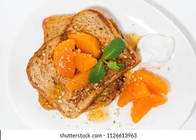 sweet french toast with jam and tangerines for breakfast, top view horizontal