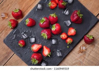 sweet fresh strawberry on black background