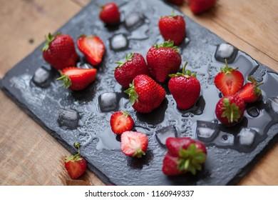 sweet fresh strawberry on black